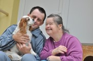 two individuals with disabilities and their pet