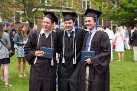 Group of 3 male graduates holding diplomas